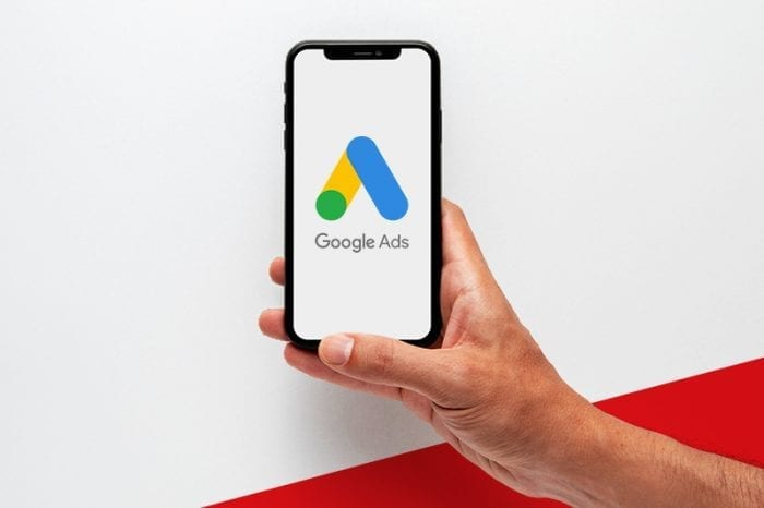 A man showing a google ads logo on smartphone